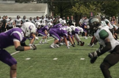 Capital University Football players lineup to run a play