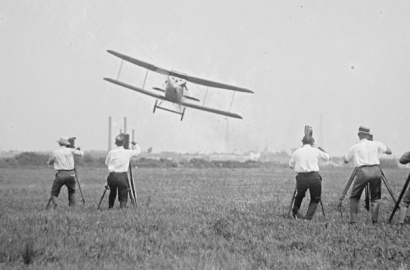 An airplane flies in Columbus, Ohio in the early 20th century.